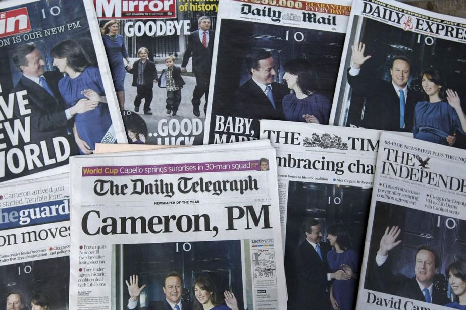 L'arrivée du tandem David Cameron-Nick Clegg à la... (Photo: AFP)