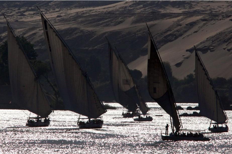 Des bateaux égyptiens traditionnels naviguent sur le Nil.... (Photo: Reuters)