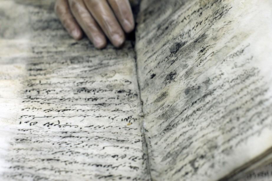 Quelque 48000 conteneurs remplis de documents, comme celui-ci,... (Photo: archives AFP)
