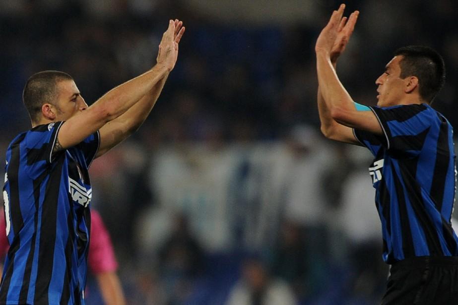Walter Samuel et Lucio... (Photo: AFP)