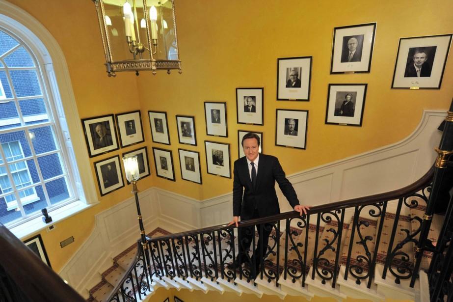 Le nouveau premier ministre britannique David Cameron dans... (Photo: Reuters)