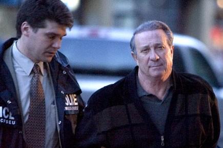 Paolo Renda (à droite), lors de son arrestation... (Photo: François Roy, archives La Presse)