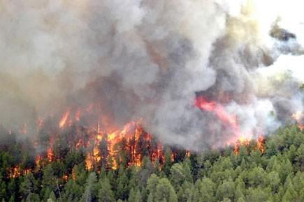 À l'heure actuelle, 16 incendies de forêt sont... (Photo: archives PC)