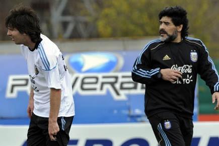 Le prodige du football argentin Lionel Messi et... (Photo: Daniel Garcia, AFP)