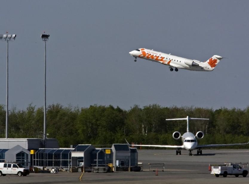 Pourquoi Air Canada n'offre-t-elle pas un tarif spécial... (PHOTO: ANDREW VAUGHAN, ARCHIVES PC)