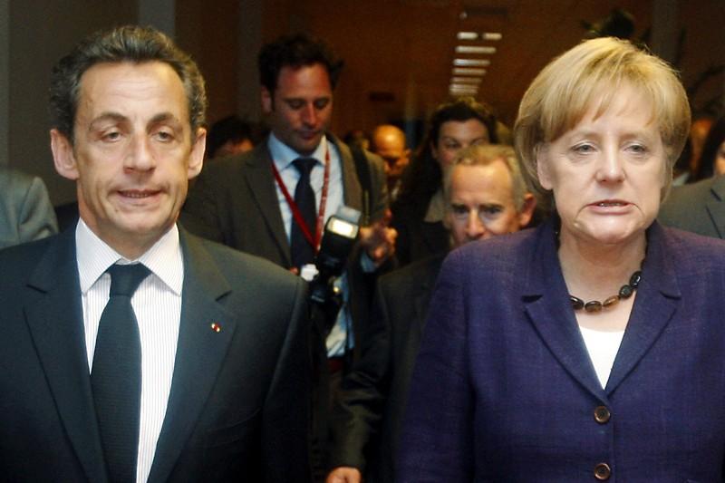 Nicolas Sarkozy et Angela Merkel.... (Photo Reuters)