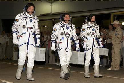 Les astronautes photographiés peu avant leur départ.... (Photo: Reuters)