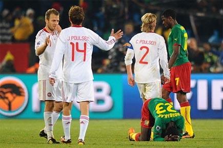 Des joueurs du Danemark célèbrent leur victoire tandis... (Photo: AFP)