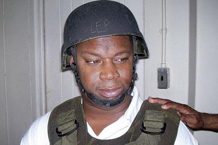 Le présumé parrain jamaïquain «Dudus» Coke protégé par... (Photo: Reuters)