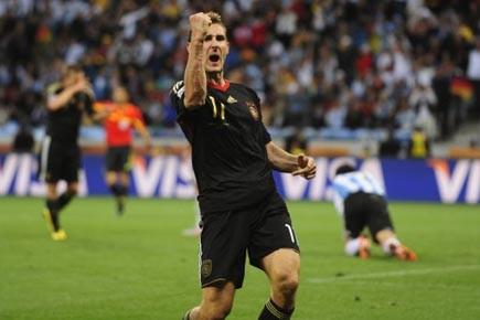 Miroslav Klose a inscrit deux buts pour aider... (Photo: John McDougall, AFP)