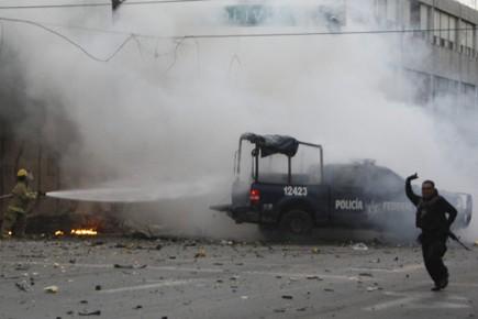 Deux policiers avaient trouvé la mort jeudi dans... (Photo: AP)
