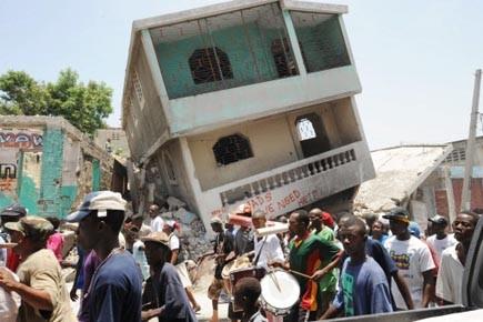 Des Haïtiens manifestent dans les rues de Port-au-Prince,... (Photo: Tony Belizaire, AFP)