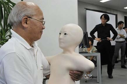 Une webcam transmet au robot l'information nécessaire pour... (Photo: AFP)