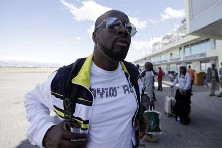 Wyclef Jean est arrivé à l'aéroport de Port-au-Prince... (Photo: AP)
