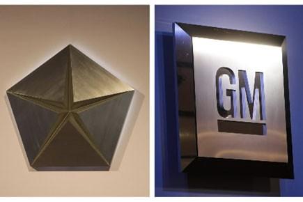 Les importantes restructurations menées par General Motors et... (Photo: AP)