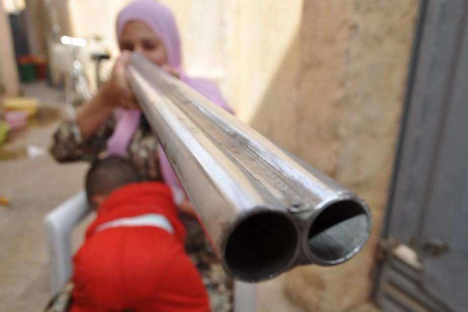 Oum Omar, 27 ans, dit avoir appris à... (Photo: AFP)