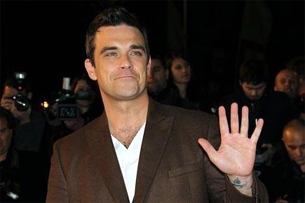 Le chanteur Robbie Williams photographié en janvier 2010.... (Photo: AFP)