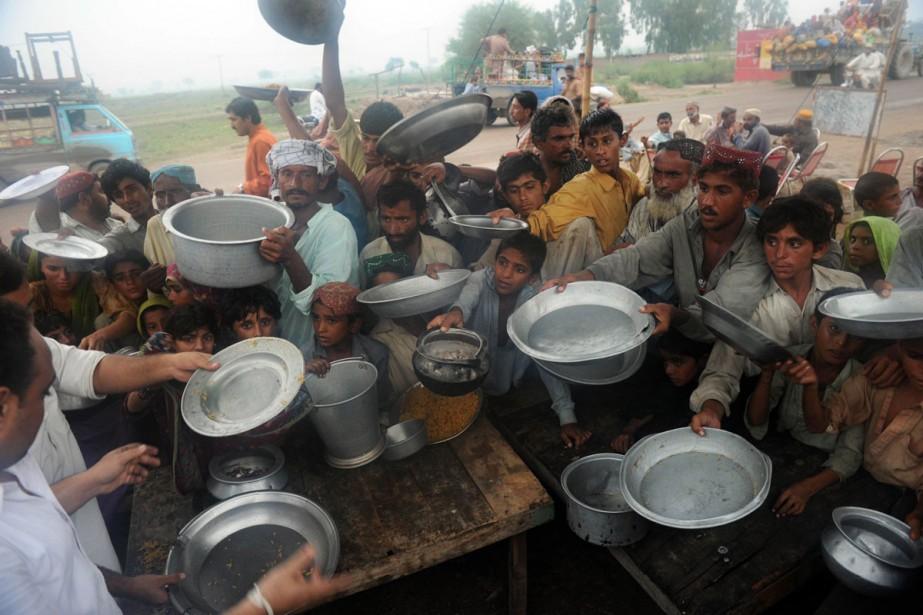 Distribution de nourriture dans un camp de réfugiés... (Photo: AFP)
