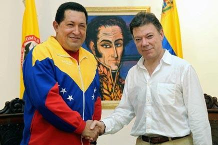 Les présidents vénézuélien et colombien, Hugo Chavez (gauche)... (Photo: Felipe Pinzon, AFP)