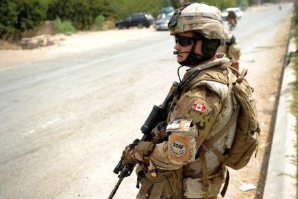 Un soldat canadien en patrouille à Kandahar.... (Photo: Yuri Cortez, Archives AFP)