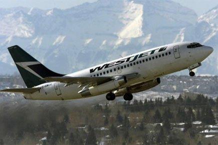 Mardi, WestJet a annoncé que son coefficient d'occupation... (Photo: PC)