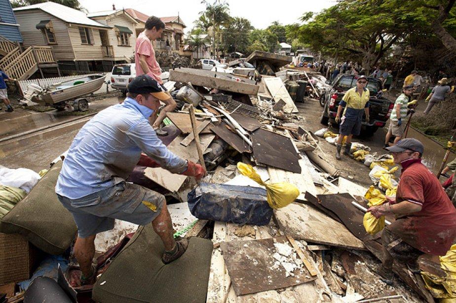 Selon le dernier bilan publié dimanche, les inondations... (Photo: AFP)