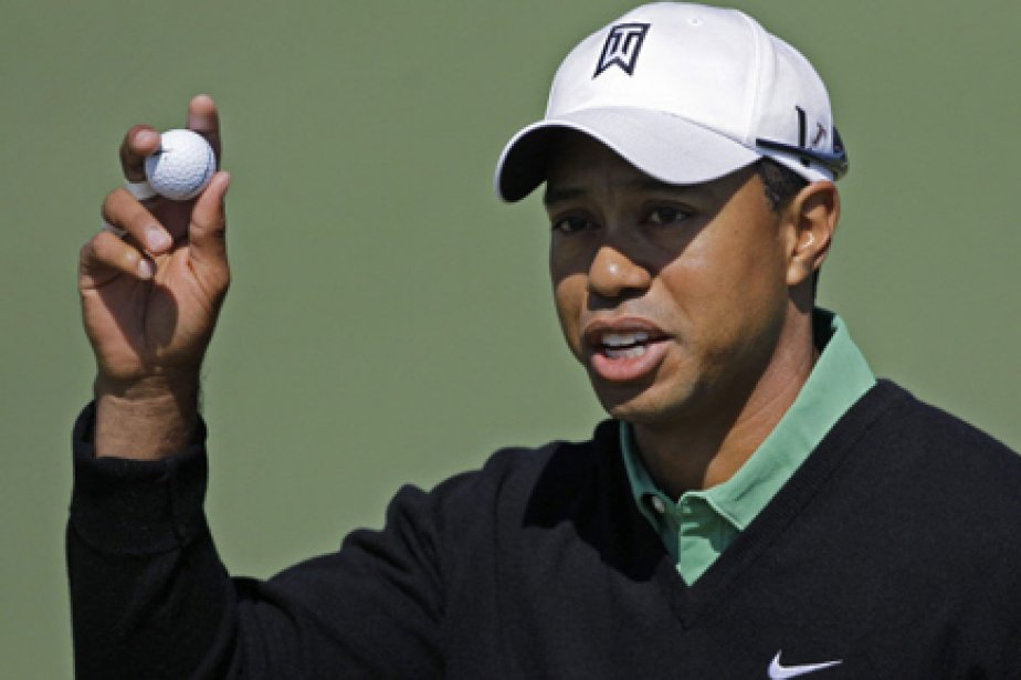 Tiger Woods débutera sa saison 2011 sur le circuit professionnel... (Photo: AP)