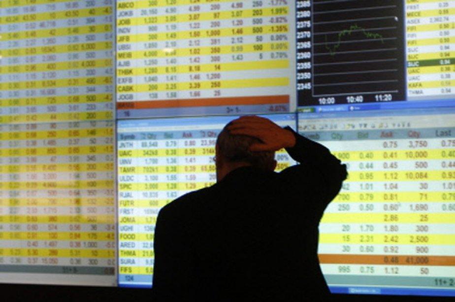 À Paris, le CAC 40 perdait 1,06%, le... (Photo Reuters)