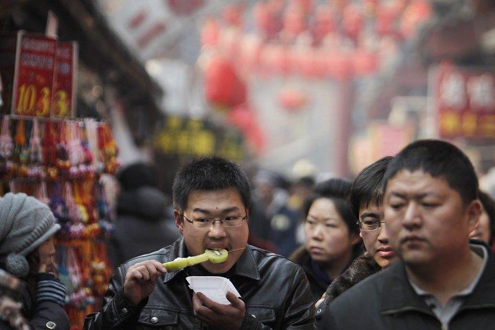 La Chine devrait surpasser le Royaume-Uni en tant que... (Photo Associated Press)