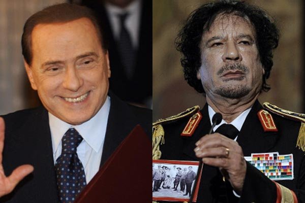 Berlusconi et Kadhafi, des hommes qui aiment avoir... (Photo AFP)