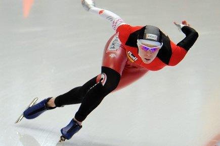 La patineuse ontarienne et championne olympique a devancé... (Photo: Kerstin Joensson, AP)