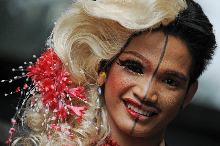 Un participant à la parade du Mardi gras... (Photo: AFP)