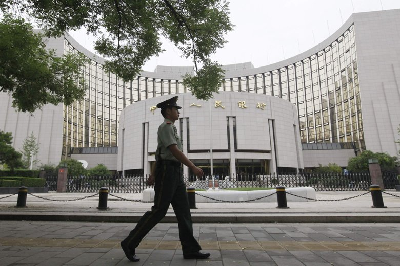 La People's Bank of China (notre photo) rejoint... (Photo Reuters)