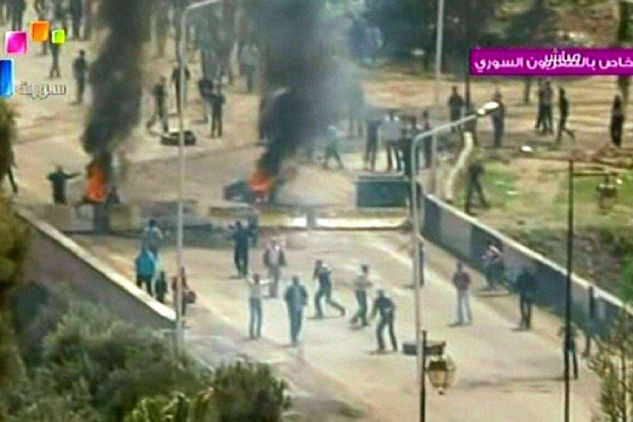 La télévision syrienne a retransmis ces images des... (Photo: AFP)