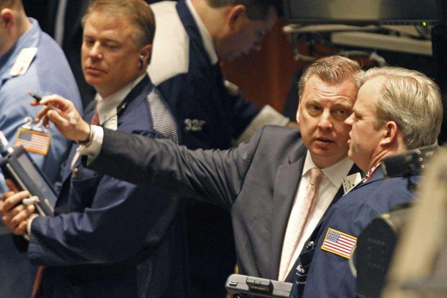 La Bourse de New York a fini en nette baisse jeudi, incapable de... (Photo AP)