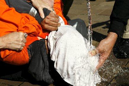 Simulation de noyade devant le département américain de... (Photo: Reuters)