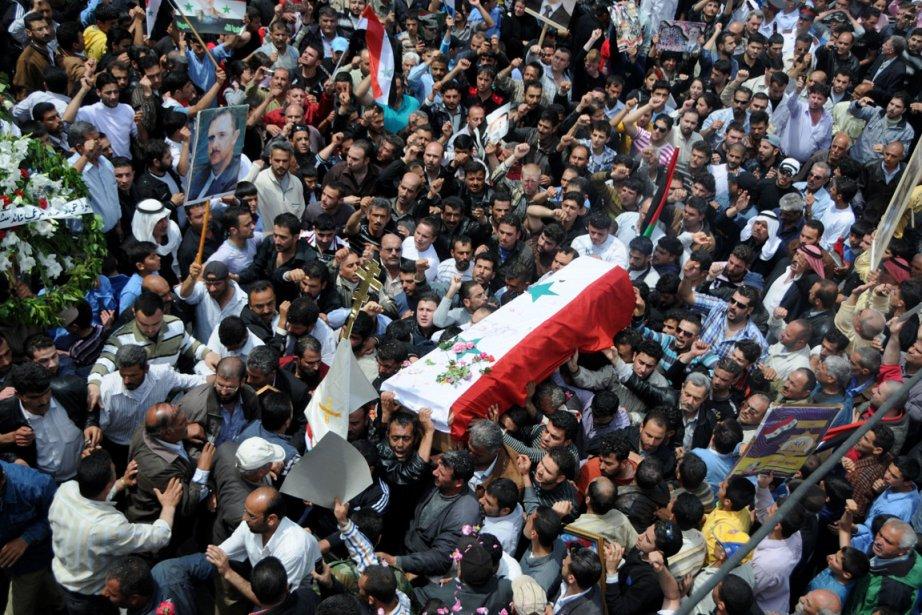 Des funérailles hier, dans le village de Mushrifa.... (Photo AFP)