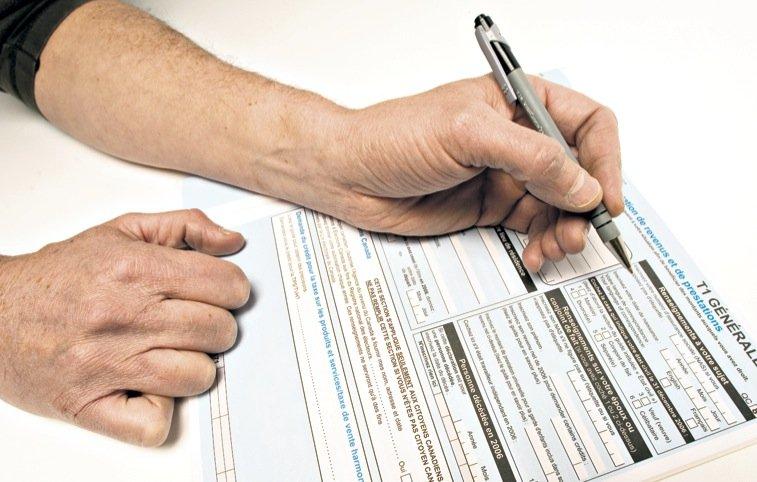 Environ 630 Canadiens ont frauduleusement réclamé des remboursements... (Photothèque Le Soleil)