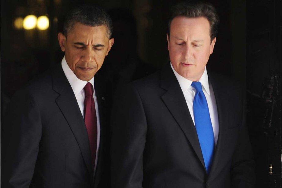 Barack Obama et David Cameron.... (Photo Associated Press)