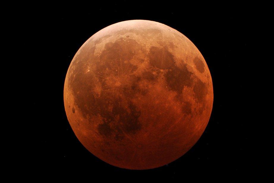 Une éclipse totale de Lune, photographiée aux États-Unis,... (Photo: Archives Reuters)