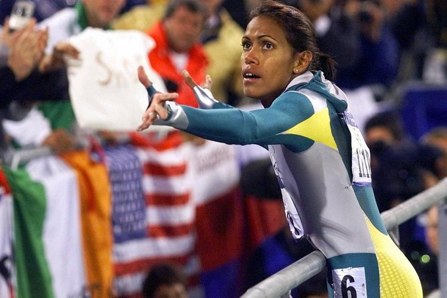 Cathy Freeman, médaillée d'or au 400m lors des... (Photo: Archives AP)