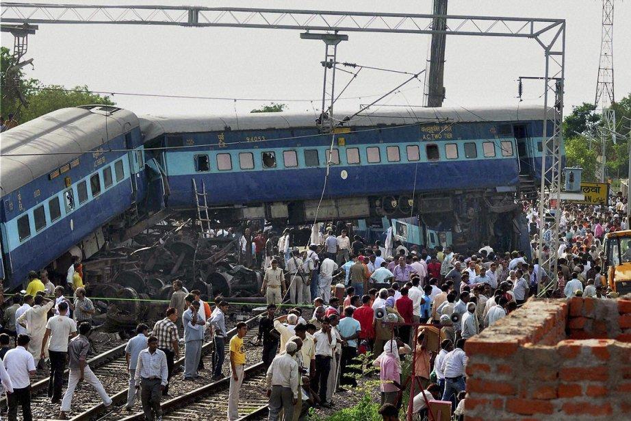 Un train de passagers a déraillé dimanche dans... (Photo: AP)