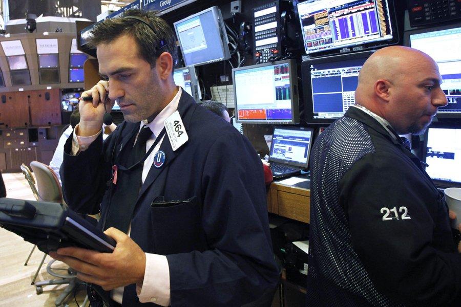Les marchés nord-américains ont clôturé en hausse, mercredi, après... (Photo: AP)