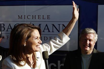 L'égérie du Tea PartyMichele Bachmann salue ses supporters... (Photo: Reuters)