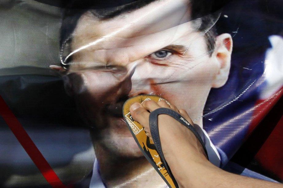 «Il [Bachar] doit démissionner et sortir de la... (Photo: Reuters)