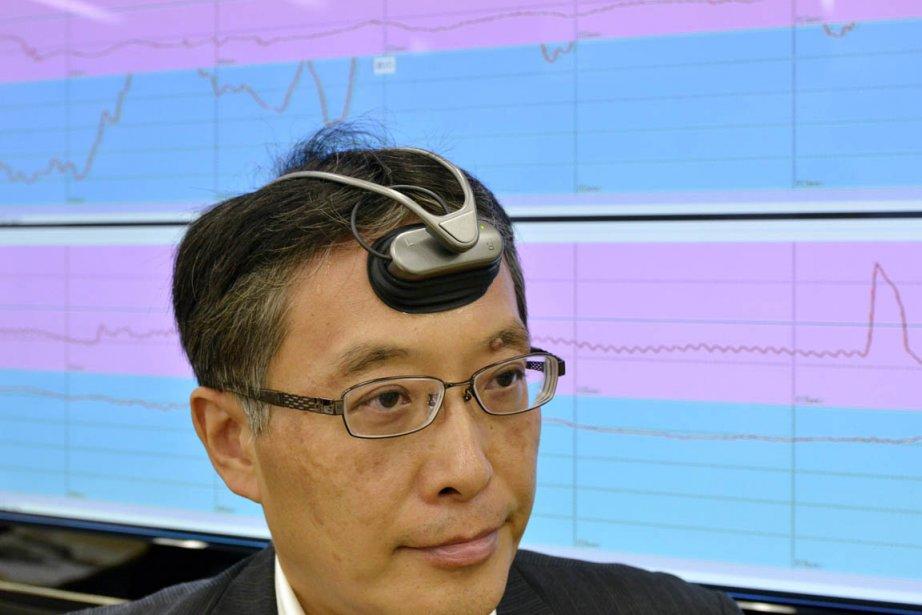 L'ingénieur Takeshi Ogino,du groupe Hitachi, a présenté aujourd'hui... (Photo: Yoshikazu Tsuno, AFP)