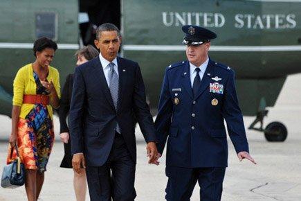 Barack Obama et sa femme Michelle ont atterri... (Photo: AFP)