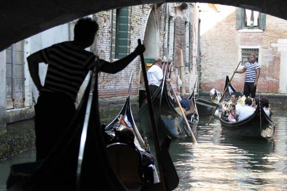Le couple de Venise n'en peut plus...... (Photo AFP)