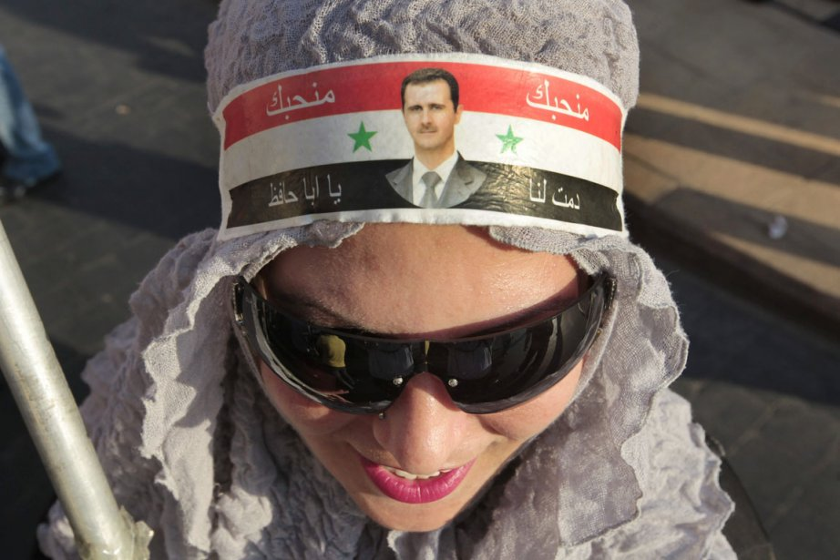 Une partisane de Bachr al-Assad lors d'une manifestation... (Photo: Hussein Malla, Archives AP)