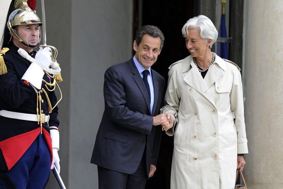Le chef de l'État français Nicolas Sarkozy et... (Photo: AFP)